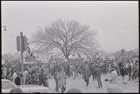 Alternate view of a mass of protesters gathered to demonstrate against Nixon's inauguration and the Vietnam War on the Mall at the counter-inaugural tent on the intersection of 15th St SW and Independence Ave SW, 19 January 1969