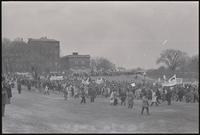 Alternate view of a protest march led by GIs and veterans sets out from 15th St SW and Independence Ave SW across the grounds of the Washington Monument. Protesters gathered to demonstrate against Nixon's inauguration and the Vietnam War, 19 January 1969