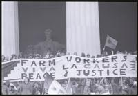 "An alternate view of a banner promoting the United Farm Workers of America (""Farm Workers, Viva la Causa, Peace & Justice"") directly in front of the Lincoln Memorial during protests against Richard Nixon's second inauguration, 20 January 1973"