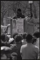 "Protesters hold signs (""Free Angela Davis"", ""No Vietnamese ever called me a nigger!"") on the back of a truck during anti-war demonstrations, possibly Vietnam War Out Now, 17-24 April 1971"