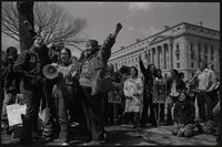 Alternate view of women chanting slogans on Constitution Ave near the Department of Justice, with images of Nguyễn Thị Bình and Ericka Huggins during anti-war demonstrations, possibly Vietnam War Out Now, 17-24 April 1971