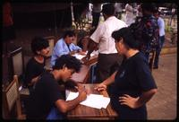 Sandinista militants signing up claimants for land/property titles