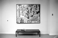 Alternate view of large painting hanging over wooden bench